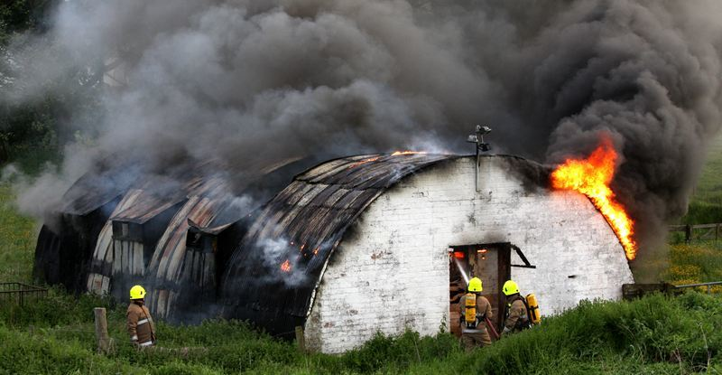 Steve MacDougall, Courier, Field in Balmossie area, Clearwater Park, off A92, Dundee. Scene of a hay fire in a farm out building. Pictured, fire crews from Kingsway East and Balmossie Fire Station at the scene.