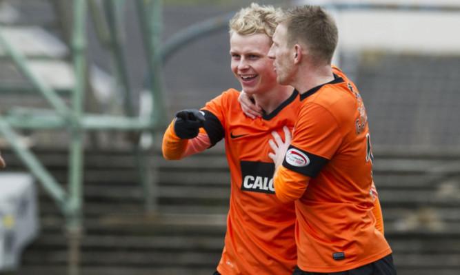Gary Mackay-Steven celebrates his goal with team-mate Michael Gardyne.