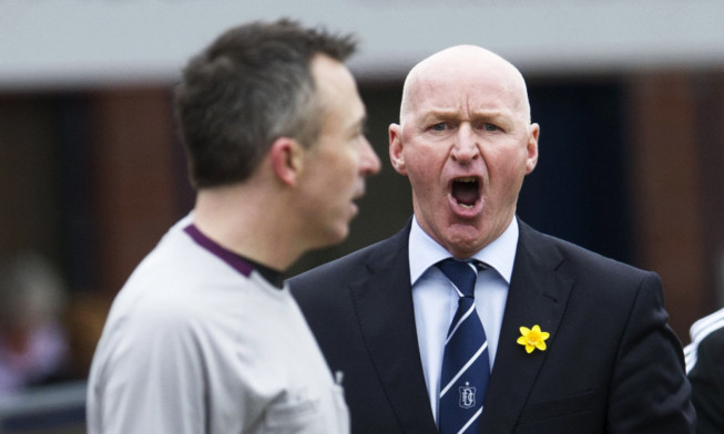 John Brown vents his fury at the fourth official.