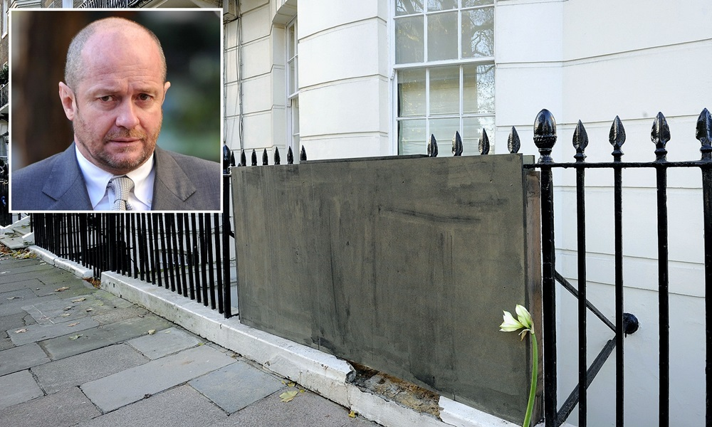 Flowers are left at the scene in Montagu Square, Marylebone, London, after bankrupt tycoon Scot Young, who was sent to prison during a vitriolic and very public divorce row, died after reportedly falling on to railings at the upmarket London property.
