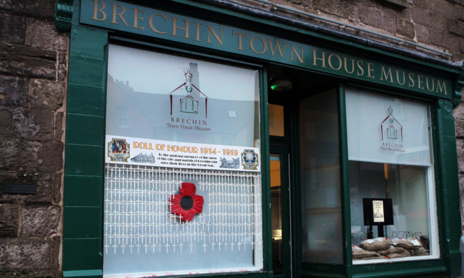 The commemorative display in the window of Brechin Town House Museum.
