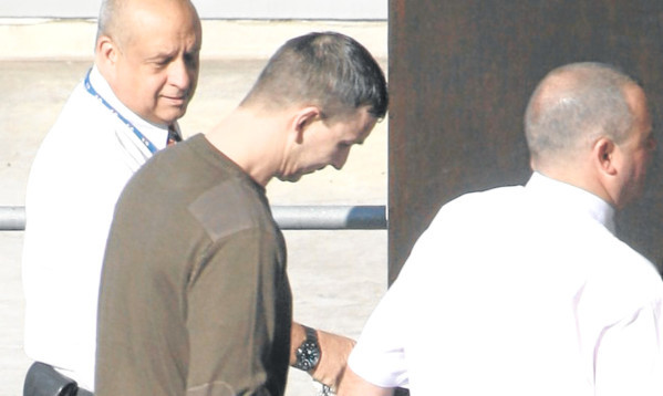 Security guards escort George Cameron at a previous court appearance.