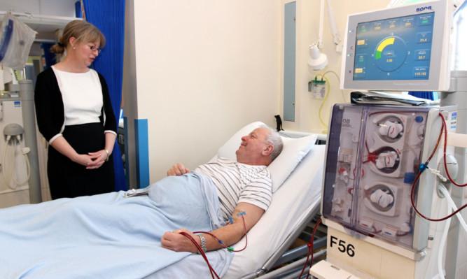 Health Secretary Shona Robison chats with patient Robert Gillbert, 63, from Kirriemuir.