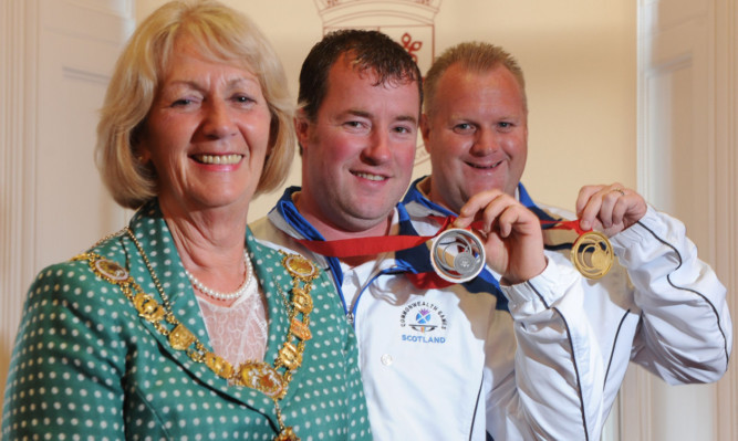 Provost Helen Oswald with Commonwealth Games medal winners Drew Christie, centre, and Darren Burnett.