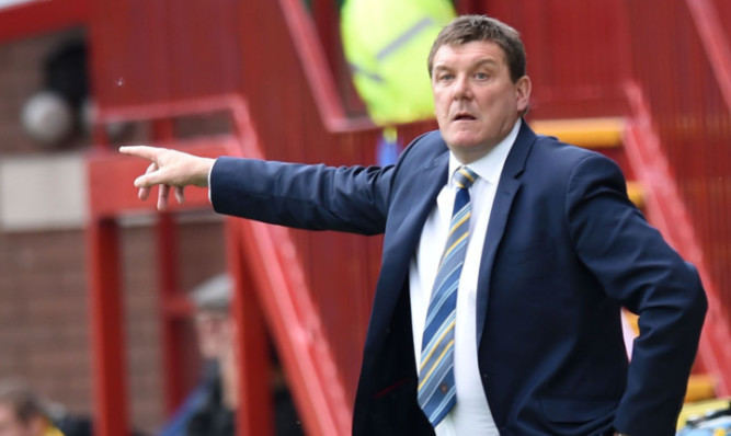 St Johnstone manager Tommy Wright gives instruction from the technical area