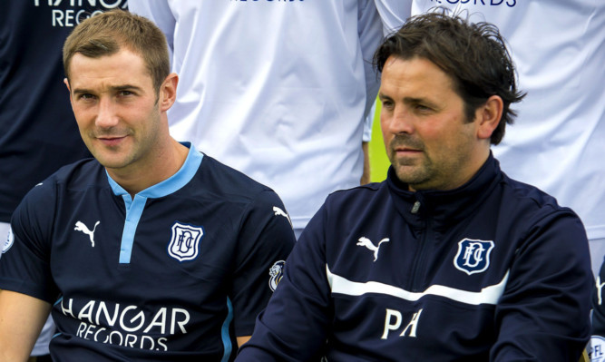 Kevin Thomson (left) and boss Paul Hartley.