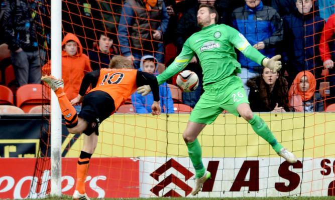 Stuart Armstong heads the ball past Celtic keeper Craig Gordon.