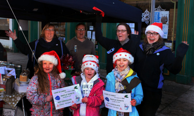 Members of the Montrose and District Brownies at their stall.