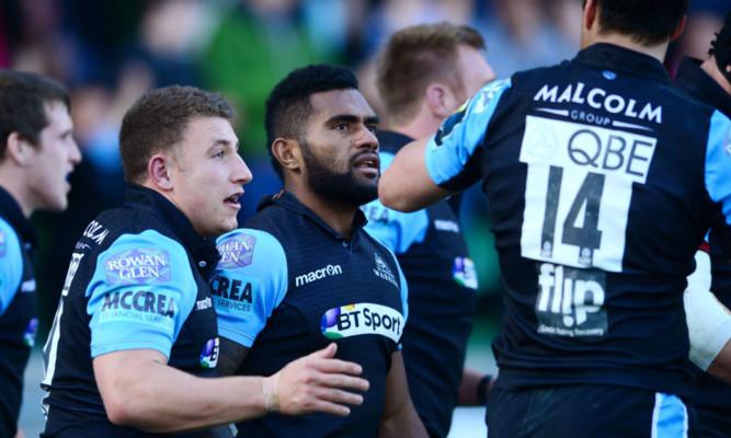 Niko Matawalu celebrates another try with Glasgow team mates.