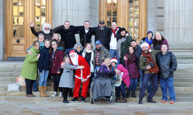 On the steps of the Caird Hall are some of the people who have participated in the Humans of Dundee project.