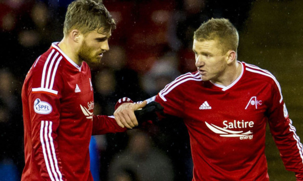David Goodwillie cuts a dejected figure after being substituted alongside Jonny Hayes.