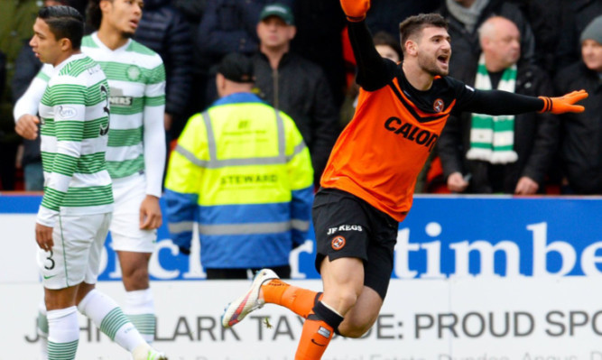 Nadir Ciftci wheels away after netting against Celtic.