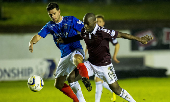 Hearts Morgaro Gomis fights for the ball with Colin Marshall.