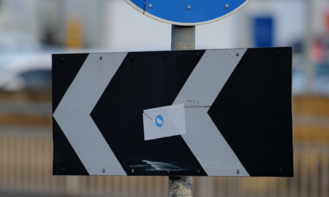 A referendum sticker on a junction box at the Glasgow Road/Riggs Road roundabout in Perth.