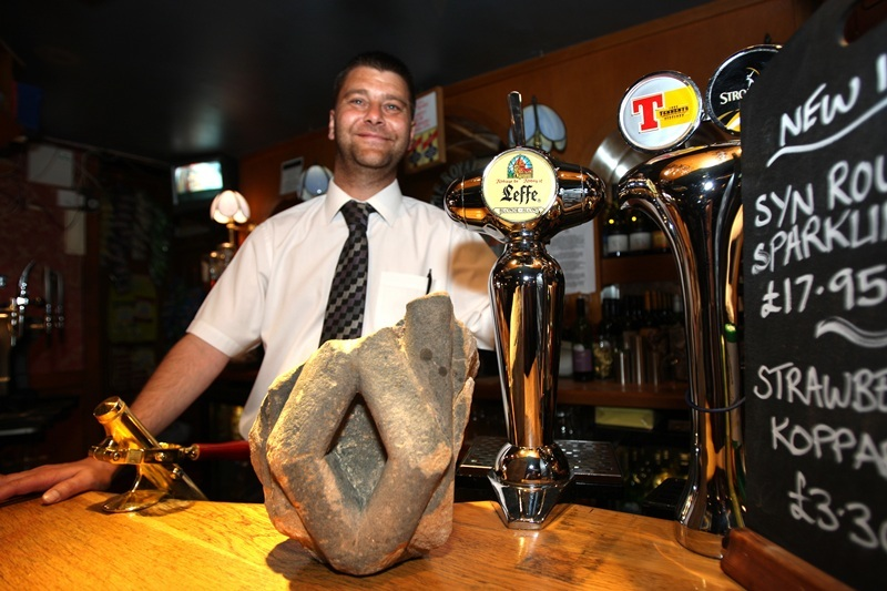 Kris Miller, Courier, 20/06/10, News. Picture today at Royal Arch pub in Broughty Ferry. Pic shows assistant manager Richard McKay in the pub with the piece of the original Royal Arch from Dundee's docks.