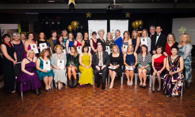 Women Ahead winners and finalists with committee members at the awards