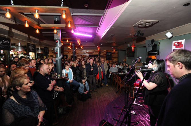28.12.14 - pictured in Calrk's, Lindsay Street, Dundee where a ticket only event - 'The Bard is Well - Songs of Michael Marra' was held - pictured is the sell out crowd listening to one of the bands