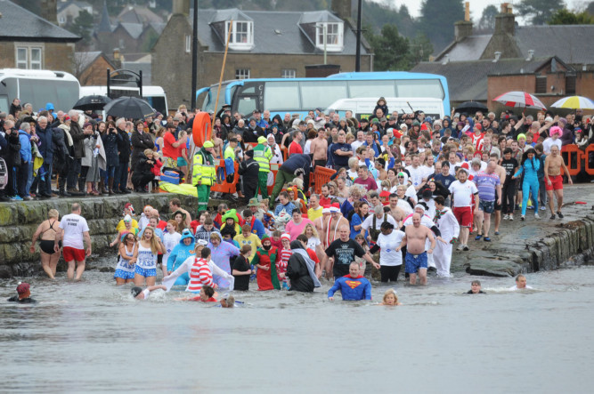 Swimmers braved bad weather to take part in the 2015 Broughty Ferry New Year Dook. Dundees Lord Provost, Bob Duncan, was at the helm of the 201 swimmers who welcomed the new year in the now traditional fashion.