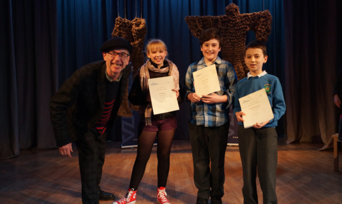 Mr Hegley with (from left) prize winners Iona Byers, Andrew Wells and Jacek Michalowicz.