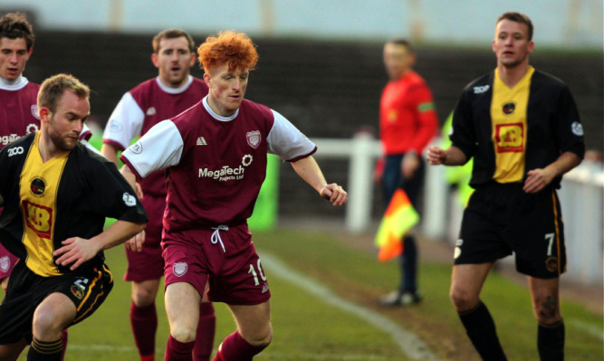 Simon Murray (centre)  in action for Arbroath.
