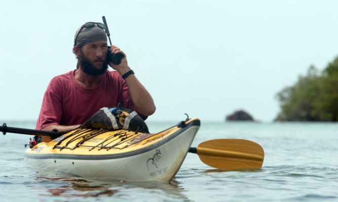 Jason Lewis takes to the water during his travels.