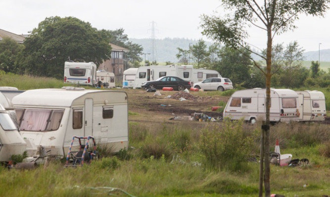 Residents were infuriated when Travellers moved on to open ground at Orchardbank Business Park, in the shadow of Angus Councils HQ in Forfar.