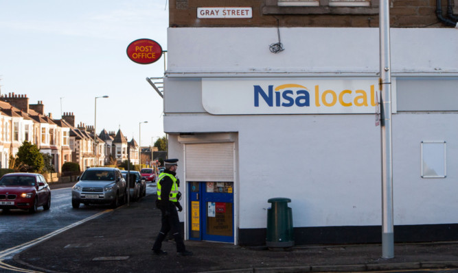 Police locked down the area for three hours following an armed robbery at the Nisa convenience store in Broughty Ferry at the weekend.