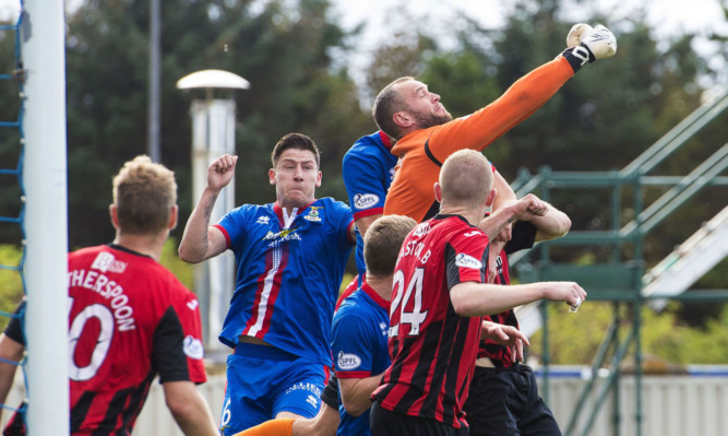 Action from the last time St Johnstone played Inverness in the Highlands.
