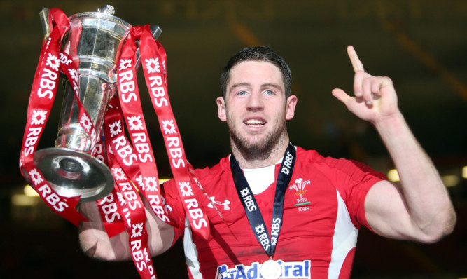 Wales Alex Cuthbert celebrates with the trophy after victory over England.