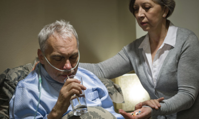 Many unpaid carers also have to hold down a job.