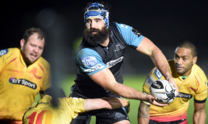 Man of the match and skipper Josh Strauss goes through the Scarlets.