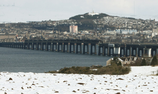 Snow in north Fife and the hills behind Dundee, with forecasts of more to come over the weekend.
