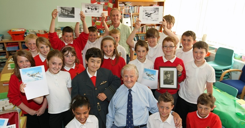 Kim Cessford, Courier - 28.06.10 - Gourdon Primary School P6/7 pupils marked the end of their terms project on WWII with a visit from war veteran Len Trevallion who was in the Met Police Force and the RAF during the war and whose great grandson Jack Ralph is in the class - pictureda re the pupils with front centre l to r - jack ralph wearing his great grandfathers unform jacket and Len Trevallion - words from Chris in Montrose