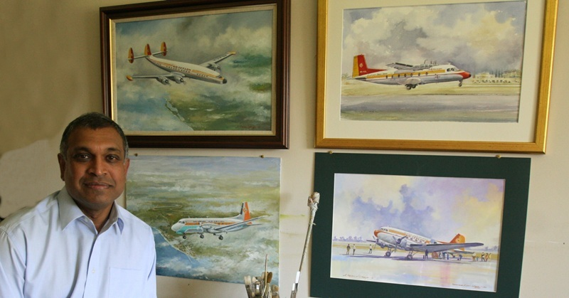 Pictured at home in Auchterarder,  is artist Allan Perera-Liyanage with some of his work on the wall.
