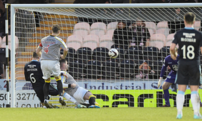 Iain Davidson fires the ball into the net for Dundee.