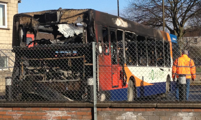 The burned-out bus at Perth station.