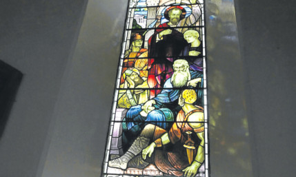One of the stained glass windows at Carmyllie Church.