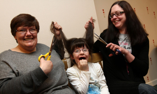 Six-year-old Iona Stewart with mum Audrey, left, and family friend Josie Robertson.