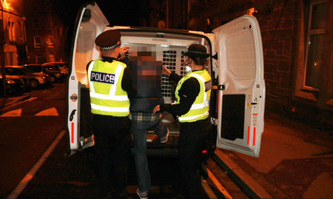 Police make an arrest after dawn raids on people in Dundee and Aberdeen.