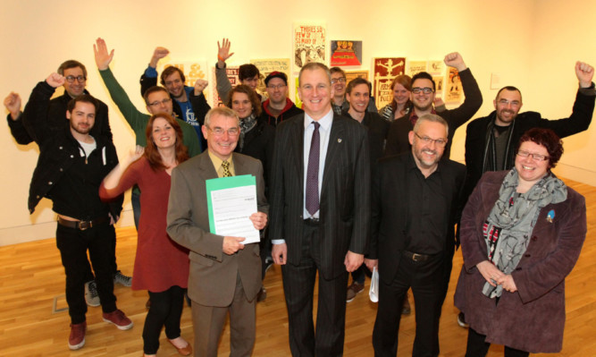 Celebrating Dundees award from Unesco are, front from left, council leader Ken Guild, Abertay University principal and vice-chancellor Nigel Seaton and director of leisure and communities Stewart Murdoch with members of the cultural team.