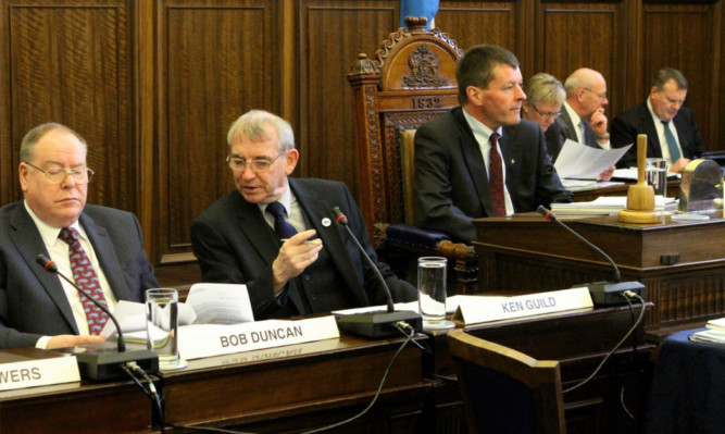 Last years council budget meeting at the City Chambers, top. This years meeting is likely to be highly charged.