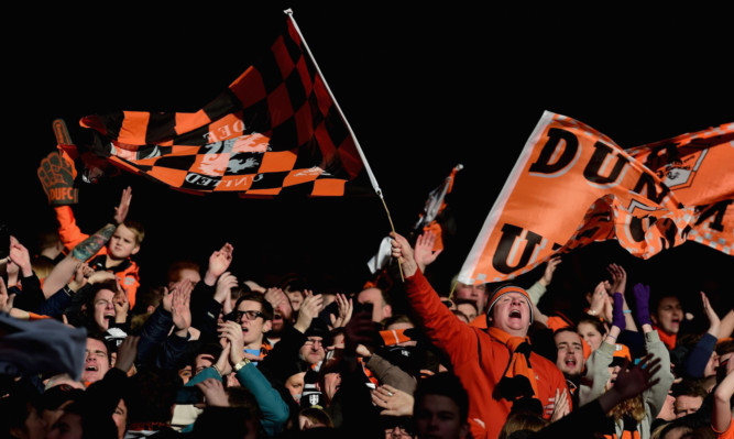 Dundee United supporters celebrate during the 2-1 League Cup semi-final victory over Aberdeen.