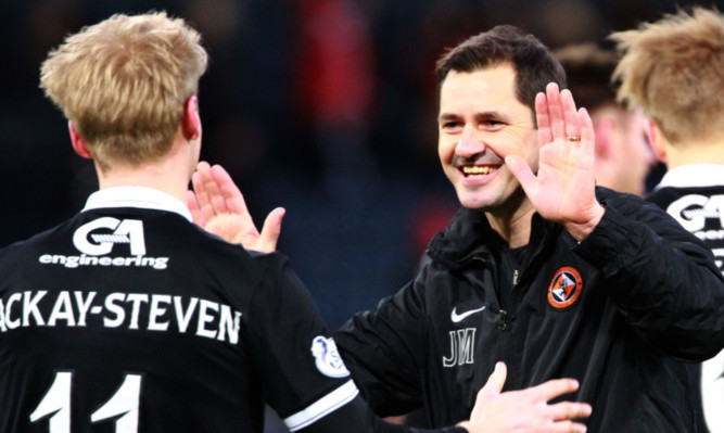 Jackie McNamara celebrates at the end of Saturday's League Cup semi-final win over Aberdeen with Gary Mackay-Steven.