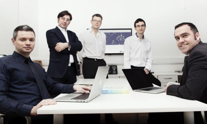 Professor Andrew Hopkins, second left, and ex scientia team members.