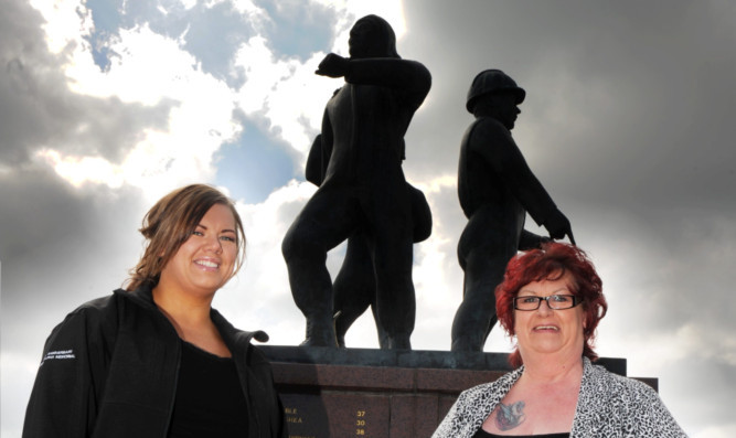Kerri Henderson (left) with mum Maureen, whose husband was killed in the tragedy