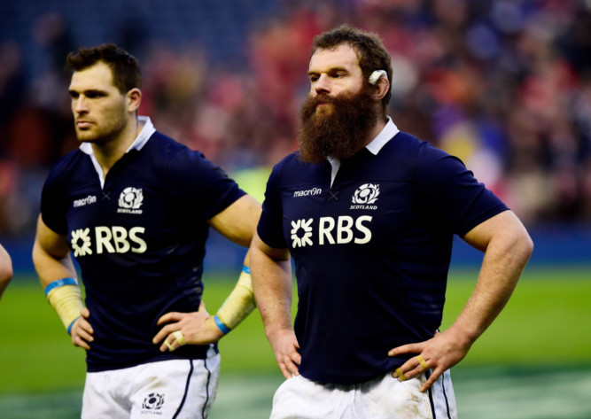 Dejected Scots Sean Lamont and Geoff Cross at the end of the game.