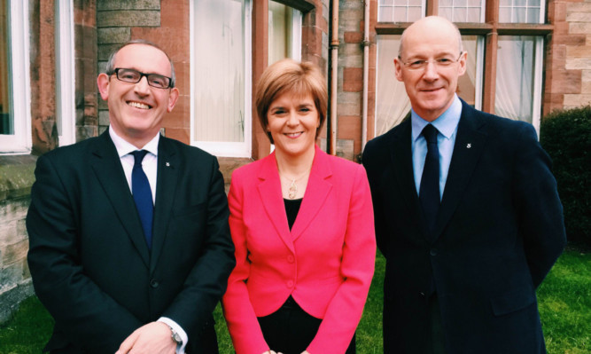 Nicola Sturgeon with Dundee East MP Stewart Hosie (left) and deputy first minister John Swinney.
