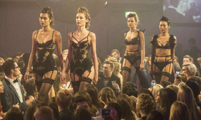 Models take to the catwalk at St Andrews Charity Fashion Show.