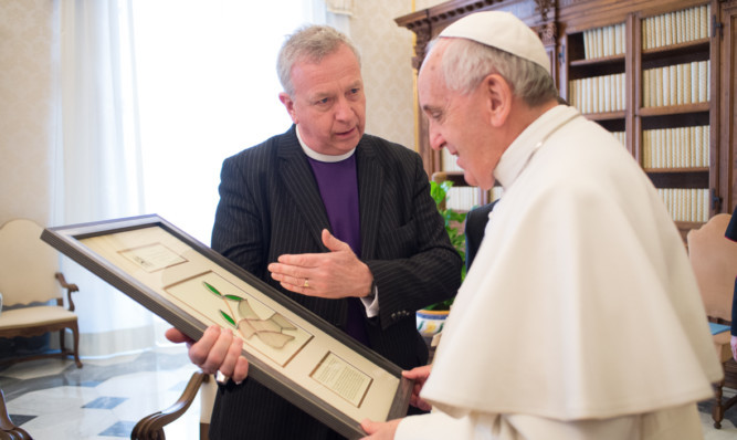 Pope Francis exchanges gifts with Reverend John Chalmers, moderator of the General Assembly of the Church of Scotland.