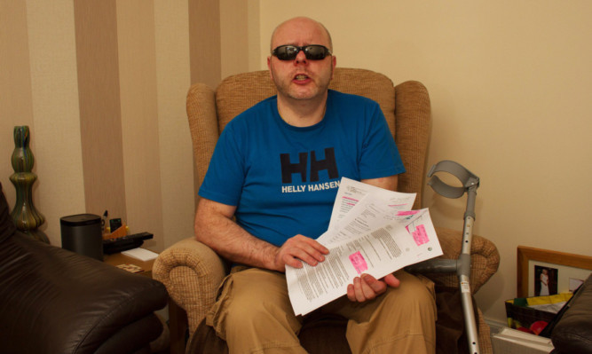 Keith Swankie from Arbroath, who has progressive supranuclear palsy, with some of the correspondence about his problems.